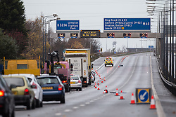 © Licensed to London News Pictures . 05/12/2013 . Manchester , UK . The M60 motorway closed by police . An overturned lorry on the Barton Bridge on the M60 orbital road around Manchester as very high winds causes damage across the UK . Photo credit : Joel Goodman/LNP