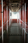 """""""Vacant Monorail"""", Spring 2021, Digital Photography, 18x24<br /> <br /> Artist Statement for """"Vacant Monorail"""" 2021<br /> """"Vacant Monorail"""" was captured this year as everyone was still subject to quarantine and social<br /> distancing. It felt like a good way to depict life in 2020 and 2021. The loneliness, the inability to<br /> go anywhere, and the lack of people being in public places is what was led to this image. There<br /> shows a peaceful stillness as the rest of the world stays dormant within their homes, but places<br /> like these feel less vibrant without the presence of people to occupy the space. The pop of color,<br /> satisfying symmetry, and bright highlights contradicts the current circumstances that may have<br /> effected many people in the last year and now. As the creator, it is fond to find the positives<br /> within the negatives."""