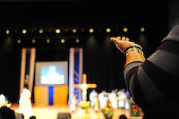 """Parishioners attending the second """"Maria La Luz Divina"""" Congress on Sunday raise their hands in prayer at Sherwood Hall. The well-attended, all-day event is sponsored by the Catholic Diocese of Monterey, and helps raise funds to keep radio programs at 1570 AM on the air."""
