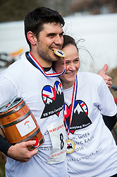 © Licensed to London News Pictures. 06/03/2016. Dorking, UK. Competitors hold their beer and medal after taking part in the 2016 Wife Carrying Race in Dorking, Surrey.  The race, which is run over a course of 380m, with both men and women carry a 'wife' over obstacles,  is believed to have originated in the UK over twelve centuries ago when Viking raiders rampaged into the northeast coast of  England carrying off any unwilling local women .  Photo credit: Ben Cawthra/LNP