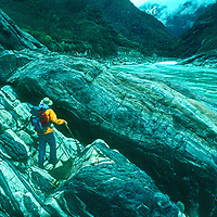 Explorer David Breashears navigates huge boulders in  the Tsangpo River Gorge, one of the world's deepest canyons, in remote southeastern Tibet, China.