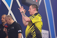 Dave Chisnall shows his frustration during the William Hill World Darts Championship Semi-Finals at Alexandra Palace, London, United Kingdom on 2 January 2021.