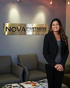 Nova Partners, Inc. associates pose for a portrait at the corporate office in Palo Alto, California, on October 1, 2015. (Stan Olszewski/SOSKIphoto)