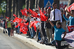 October 13, 2017 - Marmaris, Turkey - Members of the public and supporters with Turkish flags during the fourth stage - the 204.1 km Turkish Airlines Marmaris to Selcuk stage of the 53rd Presidential Cycling Tour of Turkey 2017..On Friday, 13 October 2017, in Marmaris, Turkey. (Credit Image: © Artur Widak/NurPhoto via ZUMA Press)