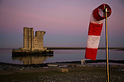 Nederland, Zeeland,  Neeltje Jans, 1-12-2009; Voormalige bouwput Oosterscheldekering met de enig overgebleven (reserve) pijler in de avondschemering.<br /> Spare pillar for the nearby Storm surge barrier in the evening<br /> foto Siebe Swart / photo Siebe Swart