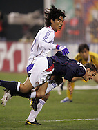 10 February 2006: Josh Wolff (16) of the U.S. is challenged by Yuji Nakazawa (22) of Japan. The United States Men's National Team led Japan 3-0 early in the second half at the Pac Bell Park in San Francisco, California in an International Friendly soccer match.