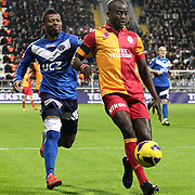 Kasimpasa's Kalu Uche (L) and Galatasaray's Dany Achille Nounkeu Tchounkeu (R) during their Turkish superleague soccer match Kasimpasa between Galatasaray at the Recep Tayyip Erdogan stadium in Istanbul Turkey on Friday 18 January 2013. Photo by Aykut AKICI/TURKPIX