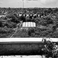 Samuel Doe's mansion.  Doe, Liberia's self-proclaimed president from 1980 to 1990, got into power by killing president Tolbert. In 1990 Doe was killed in a gruesome way by an opponent, Prince Johnson. Doe had a strong tribal link with the area he was from, thus he had a huge mansion built in Zwedru. It was never finished. The place is for sale.