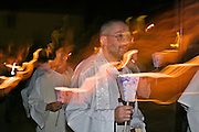 Little Walsingham, Norfolk, England, 07/04/2007..Roman Catholic pilgrims on their way to midnight mass on Easter Saturday. Pilgrims of various Christian denominations on Easter Saturday at one of Britain's oldest and most important centres of pilgrimage.