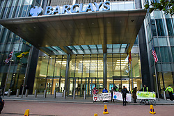 © Licensed to London News Pictures. 14/10/2019. London, UK. Extinction Rebellion protesters demonstrate outside the  Barclays offices in Canary Wharf. Today protesters will target the financial district. Photo credit: George Cracknell Wright/LNP