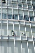 construction workers working on a high rise building