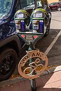 A parking meter doubles as lockable bike rack in Durango, Colorado, USA.