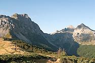 Komovi mountains, Montenegro. Komovi is a compact group of mountains near the Albanian border, close to the Prokletije mountain range. Pictured here (left to right), Kom Vasojevički, Kom Ljevoriječki and Kom Kučki (August 2006), viewed from Štavna. © Rudolf Abraham