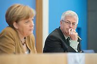 18 JUL 2014, BERLIN/GERMANY:<br /> Angela Merkel (L), CDU, Bundeskanzlerin, und Gregor Mayntz (R), Vorsitzender der Bundespressekonferenz, waehrend der sog. Sommer-Pressekonferenz der Bundeskanzlerin zu aktuellen Themen der Innen- und Außenpolitik, Bundespressekonferenz<br /> IMAGE: 20140718-01-018