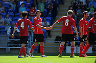 Cardiff city's Peter Whittingham © celebrates with Kim Bo-Kyung (4) and Aron Gunnarsson (8) after he scores the 1st goal. Pre season friendly match, Cardiff city v Athletic Club Bilbao at the Cardiff city stadium in Cardiff,  South Wales on Saturday 10th August 2013. pic by Andrew Orchard,  Andrew Orchard sports photography,
