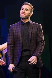 "© Licensed to London News Pictures . 12/01/2016 . Salford , UK . Writer GARY BARLOW makes a surprise appearance and performs in front of the audience at the Lowry Theatre , during the opening week of "" The Girls "" , a musical he wrote based on the story "" Calendar Girls "" , about a group of Women's Institute members in Yorkshire , who made a nude calendar . Photo credit : Joel Goodman/LNP"