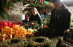 Alice Graham and Steven Roxburgh make Christmas wreaths at the Smiddy Farm Shop near Doune, Stirling.