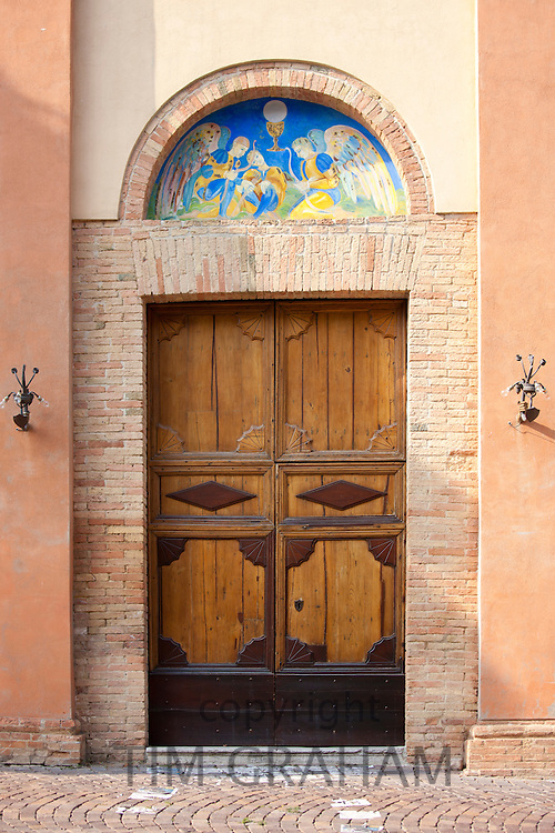 Traditional painted wall mural at church in Quartiere Ruga in Montalcino, Val D'Orcia,Tuscany, Italy