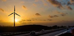 THEMENBILD - ein Windrad zur Stromerzeugung und eine Autobahn im Gegenlicht der untergehenden Sonne in einem Windpark in der Nähe von Heiligenhafen, Schleswig-Holstein, Deutschland am 02.März 2015 // a Wind turbine with a freeway backlit by the setting sun, Heiligenhafen, Schleswig-Holstein, Germany on 2015/03/12. EXPA Pictures © 2015, PhotoCredit: EXPA/ JFK