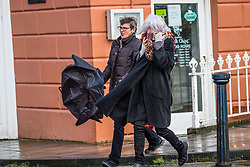 © Licensed to London News Pictures. 25/11/2017. Aberystwyth, Wales, UK. People struggle in high winds on a bitterly cold and breezy day, with heavy rain showers  and hailstorms, in Aberystwyth. Photo credit: Keith Morris/LNP
