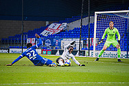 Ipswich Town defender Janoi Donacien (12) takes down Peterborough Utd Midfielder Siriki Dembele (10) resulting in a penalty as Ipswich Town goalkeeper Thomas Holy  (1) looks on during the EFL Sky Bet League 1 match between Ipswich Town and Peterborough United at Portman Road, Ipswich, England on 23 January 2021.