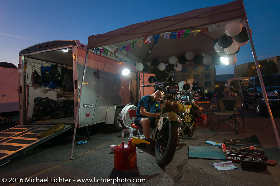 Steve DeCosa works on his 1927 Harley-Davidson JD in the hotel parking lot after stage 14 - (284 miles) of the Motorcycle Cannonball Cross-Country Endurance Run, which on this day ran from Meridian to Lewiston, Idaho, USA. Friday, September 19, 2014.  Photography ©2014 Michael Lichter.