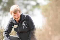 RSPB Senior Reserves Ecologist Jane Sears releasing a translocated Field cricket Gryllus campestris, RSPB Farnham Heath Nature Reserve, Surrey, April