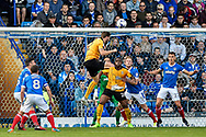 Cambridge United Defender, Greg Taylor (2) with a header at goal during the EFL Sky Bet League 2 match between Portsmouth and Cambridge United at Fratton Park, Portsmouth, England on 22 April 2017. Photo by Adam Rivers.