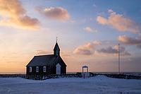 Búðir black church at sunrise in winter. Colourful clouds in sky. Snæfellsnes Peninsula, West Iceland.