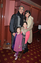RONNIE ANCONA with her husband GERARD HILL and their children Left to right, ELSA HILL & LILY HILL at a VIP evening for the pantomime Aladdin at The New Wimbledon Theatre, The Broadway, Wimbledon, London SW19 on 9th December 2013.