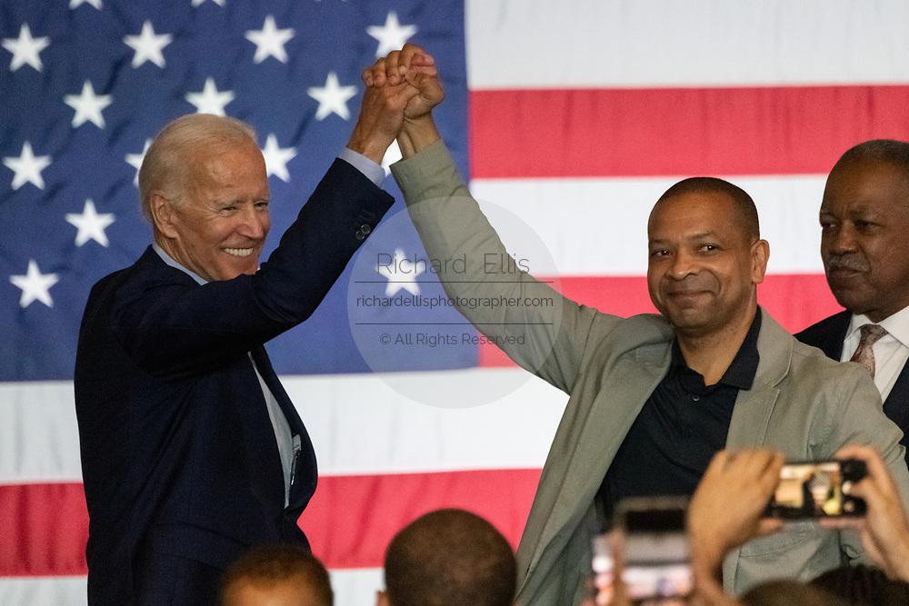 Former Vice President Joe Biden is welcomed by South Carolina State Senator Marlon Kimpson for a town hall meeting at the International Longshoreman's Association Hall July 7, 2019 in Charleston, South Carolina.