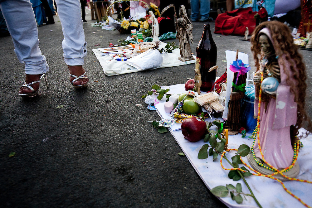 Sante Muerte figures line the street in front ot the popular Tipito Shine in Mexico city.