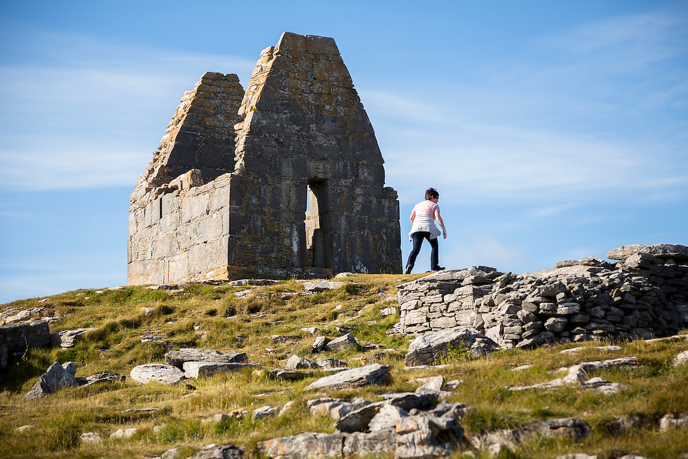 Visitor climbing to St. Benan's Church, Inishmore, Connemara, Ireland