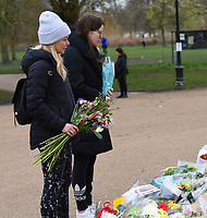 visitors pay their respects to Sarah Everard  at the bandstand on Clapham Common,  Sarah Everard. <br /> was killed after she disappeared in London on 3rd March after leaving a friend's house. Metropolitan police officer Wayne Couzens has been charged with her murder.photo by Krisztian  Elek