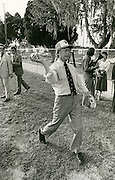 1976 Democratic presidential nominee Jimmy Carter stops his motorcade enroute to a rally in order to visit with elementary school children. Several of the children invited Carter to join them on the baseball field.
