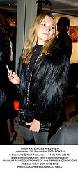 Model KATE MOSS at a party in London on 12th November 2003.POK 144