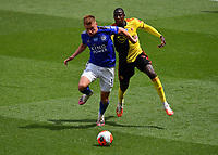 Football - 2019 / 2020 Premier League - Watford vs. Leicester City<br /> <br /> Leicester City's Harvey Barnes holds off the challenge from Watford's Abdoulaye Doucoure, at Vicarage Road.<br /> <br /> COLORSPORT/ASHLEY WESTERN