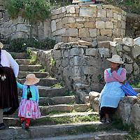 South America, Bolivia, Sun Island. Woman and child climb Incan steps on Isla del Sol.