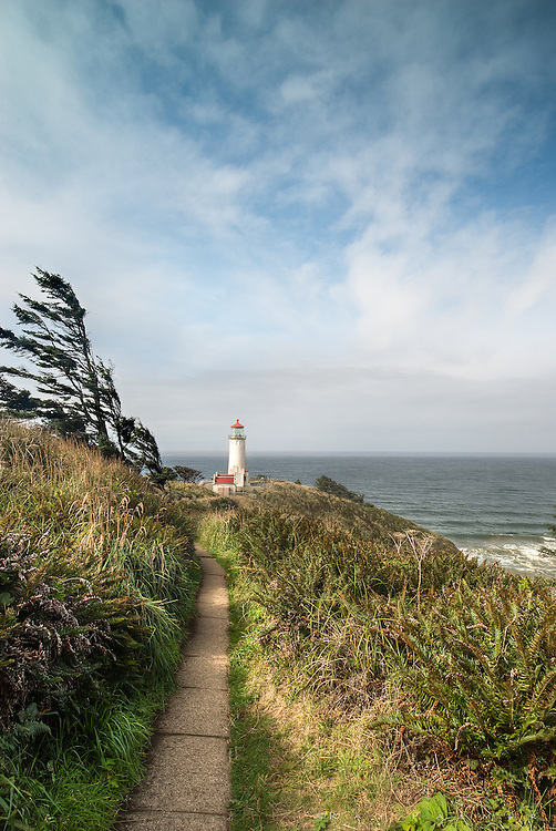 North Head Light, Washington <br /> <br /> Whether named by a British sea captain who turned back before finding the Columbia (1788) or a Lewis & Clark Expedition member who was abject at finding no ships at the end of the cross country trek (1805), Cape Disappointment is also infamous for being on a list of the 10 most depressing places in the country.  But even these places can have a good day, and I got one while travelling the coast of Oregon and Washington.  The North Head Light was built to enhance navigation, and sits on a dramatic cliff over treacherous water.  Windblown, narrow trails hug the headlands, high above the Pacific. While exploring these and avoiding the people at the light, I found composition around a little hillock above the light house pad, and waited for a lull in the breeze.  Despite the disreputable name of this area, lights rarely let you down, most being hosted by rugged real estate in spectacular locations, and North Head was no disappointment.