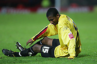 Photo: Frances Leader.<br />Watford v Sheffield Wednesday. Coca Cola Championship.<br />19/11/2005.<br />Watford's Ashley Young lies injured on the floor.