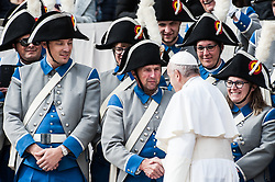 Pope Francis greets members from France of 'Societe de Musique Echo de Gibloux' during his General Audience at St. Peter's Square at the Vatican.