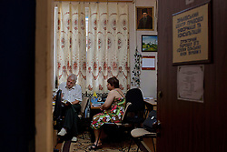 Mykola Gerasimenko, an attorney, meets with Nadia Nazarenko in a back room of the community market, Zinkiv, Ukraine, June 17, 2011. The paralegal hub is strategically located to draw people in from the community. More than half of the worldÕs population, four billion people, live outside the rule of law, with no effective title to property, access to courts or redress for official abuse. The Open Society Justice Initiative is involved in building capacity and developing pilot programs through the use of community-based advocates and paralegals in Sierra Leone, Ukraine and Indonesia. The pilot programs, which combine education with grassroots tools to provide concrete solutions to instances of injustice, help give poor people some measure of control over their lives.