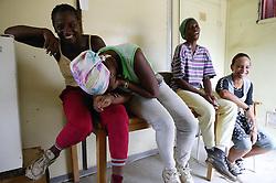 Women having fun in cabin of a building site in Havana; Cuba,