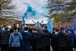 © Licensed to London News Pictures. 23/05/2021. Manchester, UK. Manchester City fans celebrate outside the Etihad Stadium after their team beats Everton at home, having already secured the Premiership title . Photo credit: Joel Goodman/LNP