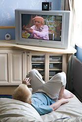 Little boy watching TV at home,