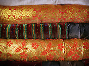 Colorful and golden Afghan Kyrgyz blankets stacked up. In Winter, Afghan Kyrgy use 4 or 5 of these blankets to keep warm.
