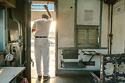 A train ticket examiner (TTE) leans out of the last wagon on the Vivek Express as he prepares to leave at the end of his shift.<br /> Inside the Dibrugarh-Kanyakumari Vivek Express, the longest train route in the Indian Subcontinent. It joins Kanyakumari, Tamil Nadu, which is the southernmost tip of mainland India to Dibrugarh in Assam province, near the border with Burma.