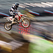 A blur of motion as Frank Lettieri, Honda, flies through the air during the Monster Energy AMA Supercross series held at MetLife Stadium. 62,217 fans attended the event held for the first time at MetLife Stadium, New Jersey, USA. 26th April 2014. Photo Tim Clayton