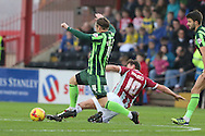 Dannie Bulman of AFC Wimbledon and Lee Holmes of Exeter City during the Sky Bet League 2 match between Exeter City and AFC Wimbledon at St James' Park, Exeter, England on 28 December 2015. Photo by Stuart Butcher.