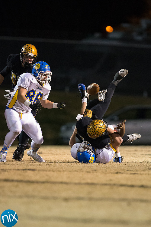 Shelby Golden Lions quarterback Darquez Lee (11) fumbles the football as he is sacked by Dakota Wensil (32) of the Mount Pleasant Tigers during first half action at George Blanton Memorial Stadium November 27, 2015, in Shelby, North Carolina.  The Golden Lions defeated the Tigers 38-27.  (Brian Westerholt/Special to the Tribune)
